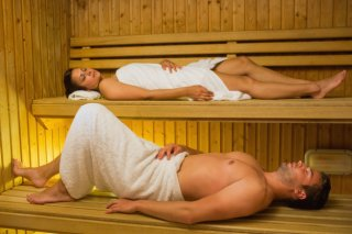 calm-couple-relaxing-in-a-sauna_13339-28467