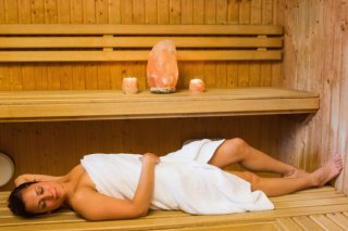 happy-brunette-woman-lying-in-a-sauna_13339-120329
